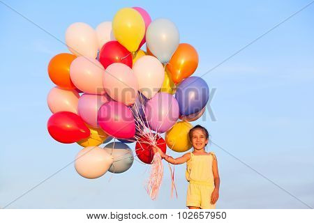 Happy Little Girl Child Kid With Balloons Outdoors On Sky Background
