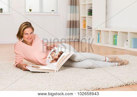 Woman Looking At Photo Album