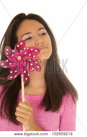 Beautiful Latino Teen Girl Holding A Pink Toy Windmill