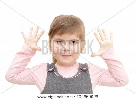 little girl rises hends up and shows ten fingers on white