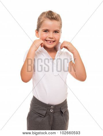 Cute little girl standing on white background and correcting her collar