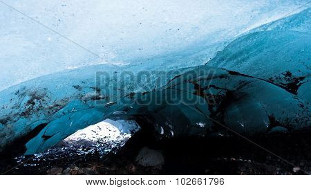 Dangerous tunnel through glacier ice at Vatnajokull, Iceland