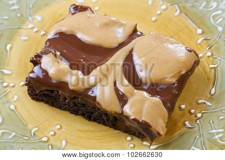 Peanut butter and chocolate topped cake
