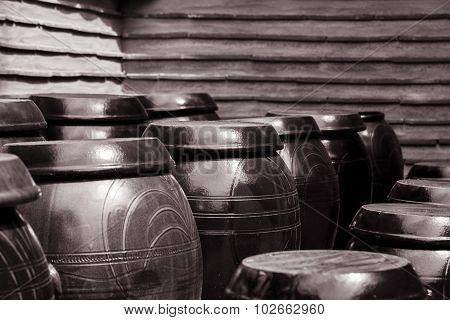 Black And White Shot Of Ancient Japanese Crocks
