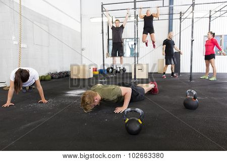 Workout group does exercises at fitness gym