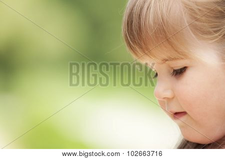 Face Of Little Girl In The Park