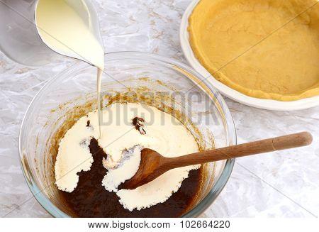 Pouring Cream Into Pumpkin Pie Filling