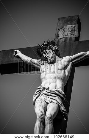 Statue of Jesus Christ at cross at the Palace of the Popes in Avignon, France