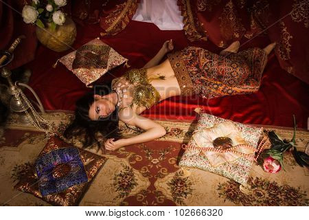 Crime Scene Imitation: Lifeless Woman In Oriental Costume Lying On A Floor