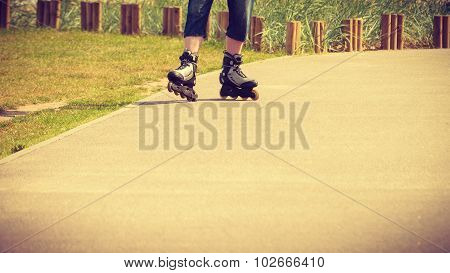 Young Man Roller Skating Outdoor On Sunny Day