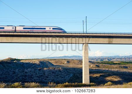 view of a high-speed train crossing a viaduct in Roden, Zaragoza, Aragon, Spain.
