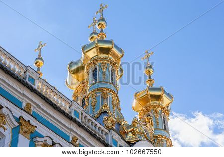 Golden Domes Of The Church Of The Resurrection Of Christ Against Blue Sky