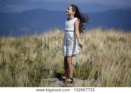 Cute Girl In Mountains