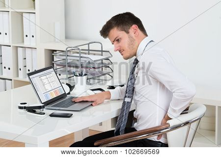 Businessman Suffering From Backpain In Office
