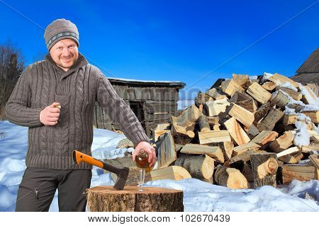 Man collecting firewood in winter outdoor