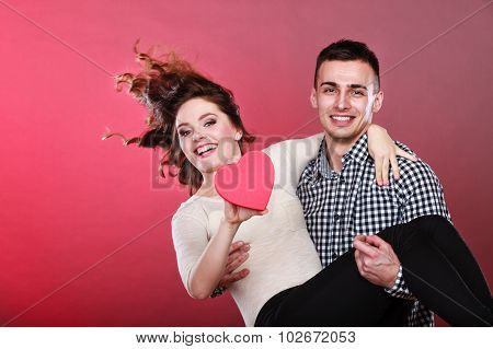 Man Holds Woman With Paper Heart