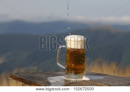 Pouring Beer In Mountains