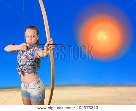 Teen girl practicing archery