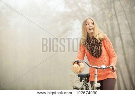 Happy Woman With Bike Bicycle In Autumn Park.