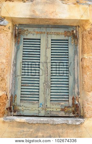 Window Of An Old Apartment Building In Malia.