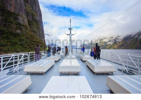Milford Sound New Zealand-august30 : Visitor On The Roof Of Sea Cruise Seeing Inside Of Milford Soun