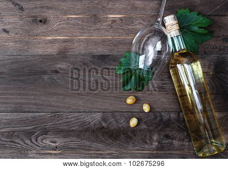 Bottle Of Wine And Fresh Grape On Wooden Background