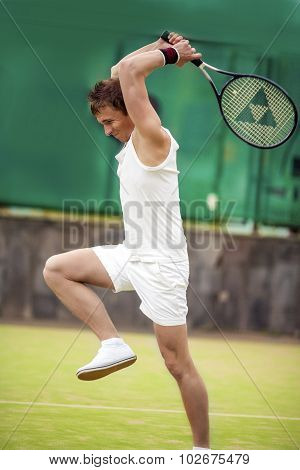 Tennis Concept: Portrait Of Expressive Caucasian Man With Tennis Racquet On Court.