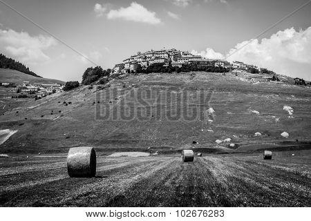 Hay Bails On The Field In Castelluccio Di Norcia, Italy