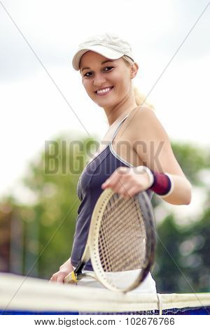 Tennis And Health Life Concept: Portrait Of Positive Smiling Professional Female Tennis Player Posin