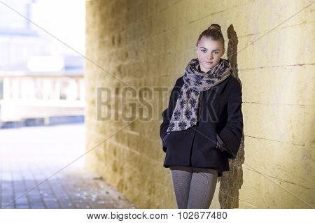 Modern Lifestyle Concept And Ideas. Trendy Positive Caucasian Female Posing In Coat Outdors.