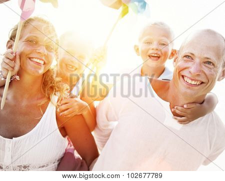Family Windmill Sea Vacation Holiday Piggyback Concept
