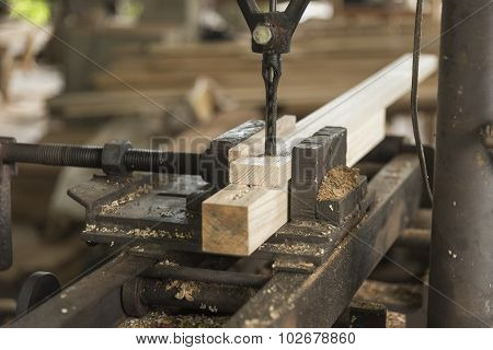 Close-up of carpenter cutting a wooden plank