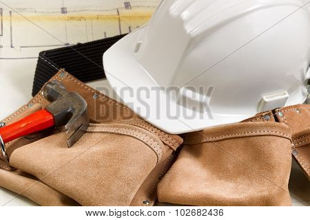 Construction Contractor Tools With Blue Print Drawings In Background