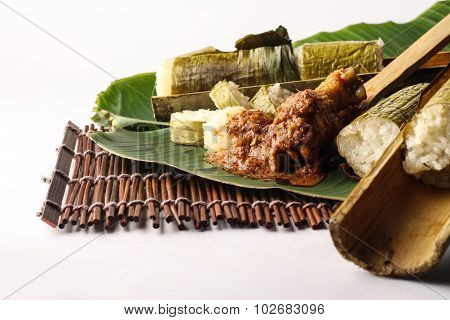 lemang with chicken rendang