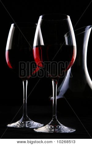 Two elegant glasses with red wine