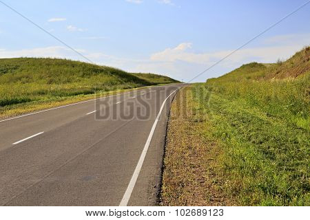 Beautiful road among farm fields.