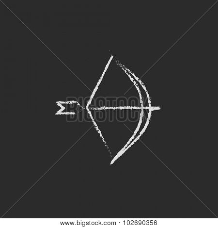 Bow and arrow hand drawn in chalk on a blackboard vector white icon isolated on a black background.