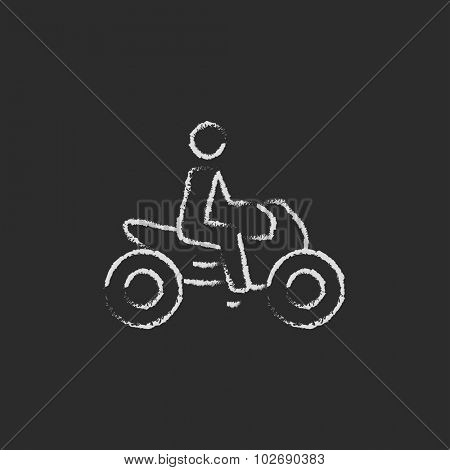 Rider on a motorcycle hand drawn in chalk on a blackboard vector white icon isolated on a black background.