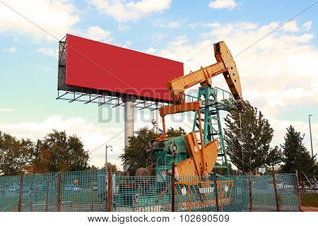 Golden Yellow Oil Pump And Billboard Of Crude Oilwell Rig