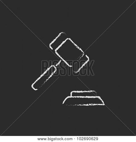 Auction gavel hand drawn in chalk on a blackboard vector white icon isolated on a black background.
