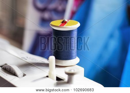 Colored Bobbins Thread Background