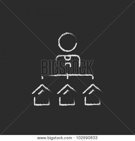 Real estate agent with three houses hand drawn in chalk on a blackboard vector white icon isolated on a black background.