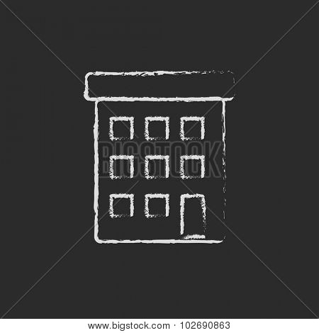 Condominium building hand drawn in chalk on a blackboard vector white icon isolated on a black background.