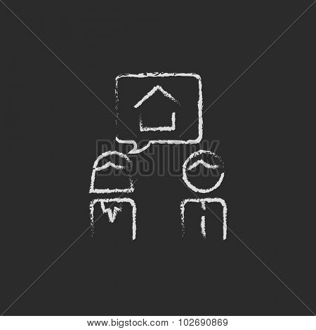Couple dreaming about the house hand drawn in chalk on a blackboard vector white icon isolated on a black background.