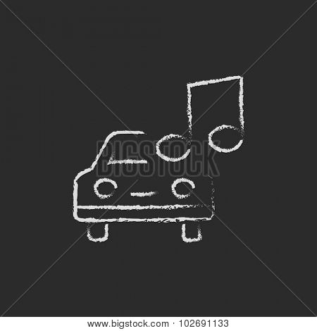 Car with music note hand drawn in chalk on a blackboard vector white icon isolated on a black background.