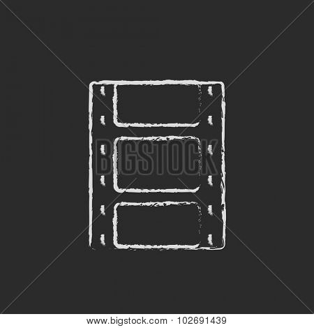 Negative hand drawn in chalk on a blackboard vector white icon isolated on a black background.