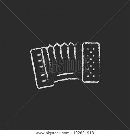Accordion hand drawn in chalk on a blackboard vector white icon isolated on a black background.