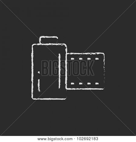 Camera roll hand drawn in chalk on a blackboard vector white icon isolated on a black background.