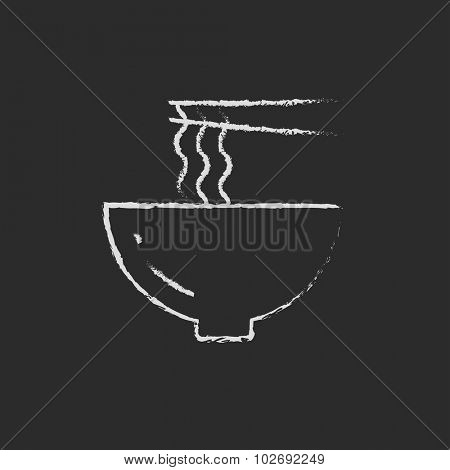 Bowl of noodles with a pair of chopsticks hand drawn in chalk on a blackboard vector white icon isolated on a black background.