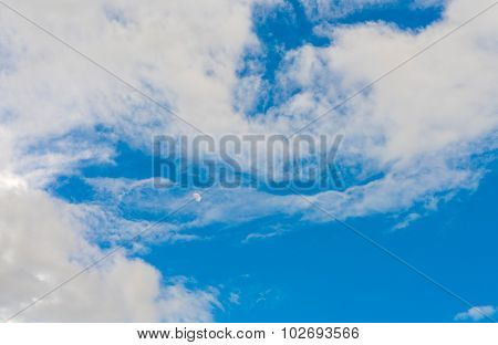 Cloud in blue sky with moon